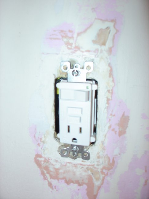 Replacing a light switch with a combination light switch and outlet
