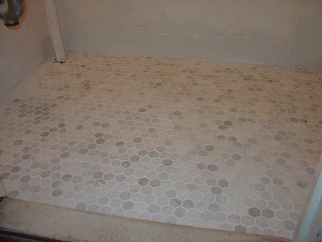 white marble hex tiles